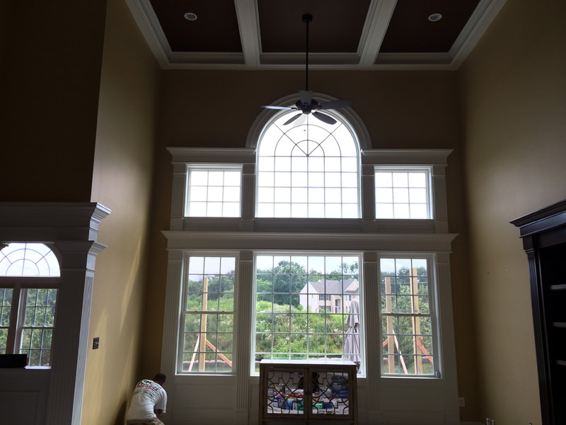 Painters in great room finishing the interior painting project.