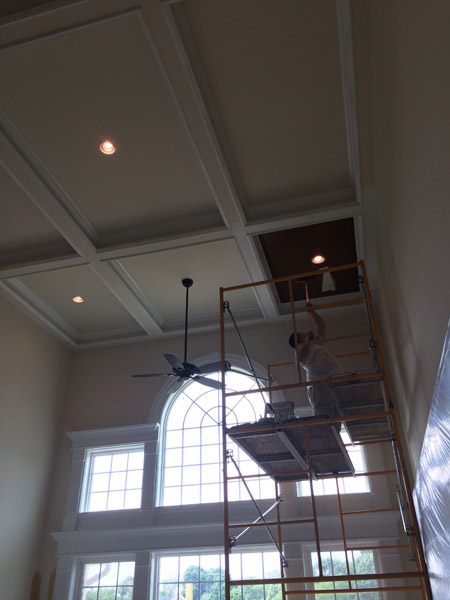 Painting an accent color coffered ceiling in a family room